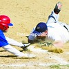 Airborne Speedway Padres' first baseman Eric Bell dives to the bag to just nip Plattsburgh Cardinals' runner Cliff Conners during the second game of Sunday's CVBL doubleheader at South Acres Field. The Expos took two by scoring of 13-2 and 15-14.<br><br>(P-R Photo/Gabe Dickens)