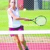 Northeastern Clinton's Paige Southwick focuses on her next hit during the No. 2 singles match against Saranac in CVAC tennis Wednesday. Southwick and the NCCS teams won.<br><br>(Staff Photo/Ryan Hayner)