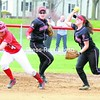 Plattsburgh State shortstop Nicole Diemer catches Cortland's Cassie Kardias in a rundown as Plattsburgh's Allison Smiddy watches during a softball doubleheader Friday at Cardinal Park. The Red Dragons won both games.<br><br>(P-R Photo/Andrew Wyatt)