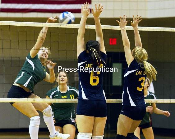Lake Placid's Joanna Politi (6) and Lindsey Howe (3) go up to defend a hit by Northern Adirondack's Allison LaMountain during the Section VII Class D volleyball final Saturday. The Bobcats won, 3-1.<br><br>(P-R Photo/Gabe Dickens)