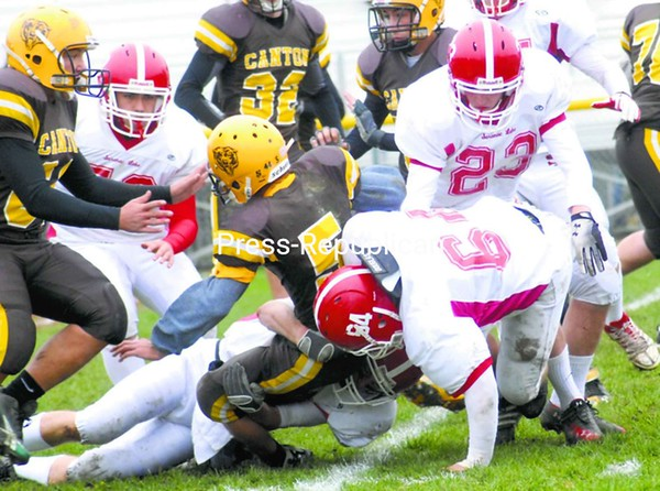 Saranac Lake's Idriz Cecunjanin (24) chaces after Potsdam quarterback Jay Proulx during a Section VII/X Class C football semifinal game Saturday at Ken Wilson Field. The Red Storm won, 49-22.<br><br>(Staff Photo/Ryan Hayner)