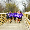 The Ticonderoga High School track team runs across the new Trestle Trail footbridge between Lake George Avenue and Alexandria Avenue. <br><br>(Staff Photo/Lohr McKinstry)