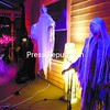 Ghouls and ghosts adorn the porch at the corner of Oak and Elm streets in Plattsburgh.<br><br>(P-R Photo/Gabe Dickens)