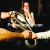 Kate Pierce gasps for breath as she looks at a fluffy eastern rat snake during the third-annual Adirondack Youth Summit held Wednesday and Thursday at the Wild Center in Tupper Lake. More than 160 high-school students attended the two-day affair. A number of hands-on displays were available at the summit, and one of the goals of the gathering was to find new ways to conserve energy.<br><br>(P-R Photo/Jack LaDuke)