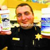 Essex County Sheriff's Deputy Shawn LaPier holds four of the hundreds of drug containers turned in at Kinney Drugs in Elizabethtown on Saturday. The prescription-drug dropoff, held in several local communities, was monitored by the Drug Enforcement Agency, which takes the collected pharmaceuticals away and incinerates them. What is turned in and from whom is completely anonymous as the containers are dropped into boxes by the participants. The drugs ranged from controlled substances to outdated over-the-counter medications.<br><br>(Staff Photo/Alvin Reiner)