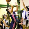 Westport's Allison Sherman (left) goes for a lay-up against Ticonderoga's Kylie Austin during a first-round girls' basketball game in the Alzheimer's Awareness Tournament Tuesday. The Eagles won, 43-29.<br><br>(Staff Photo/Alvin Reiner)
