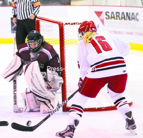 Plattsburgh State's Teal Gove (16) prepares to take a shot against Potsdam goalkeeper Jen Conophy during a ECAC West women's hockey game at Stafford Ice Arena Saturday. Bonus photos will be available midday Monday at pressrepublican.com.<br><br>(P-R Photo/Rob Fountain)