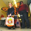 Saranac Elementary School kindergartner Samantha Warren floats down the hall on butterfly wings Friday during Trick-or-Treat Safe Street at Saranac Middle School. The event included candy, pumpkin carving and more.<br><br>(P-R Photo/Rob Fountain)