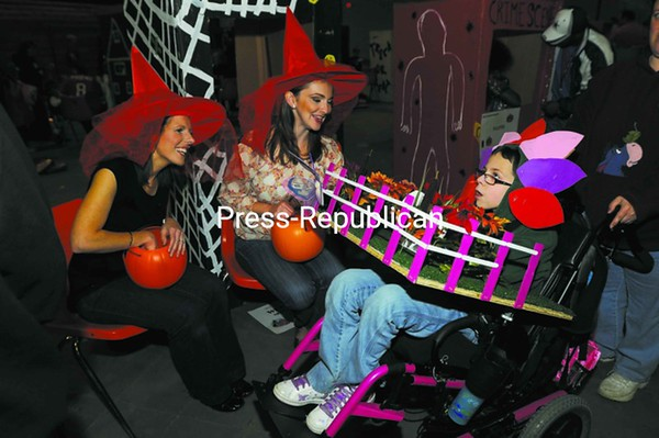 Erika Duso is dressed as a garden as she receives candy from Mary Morin (left) and Hayley LaPoint during the eighth-annual Trick or Treat on Safety Street at the Crete Civic Center in Plattsburgh Friday. The event attracted thousands of kids in costumes; more than two tons of candy was expected to be handed out throughout the evening. More than 35 organizations and 30 college students volunteered their time to participate in this year's event. Check out video from this year's Safety Street at www.pressrepublican.com.<br><br>(P-R Photo/Rob Fountain)