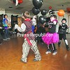 Kids play with balloons at American Legion Post 1619 in West Plattsburgh during the legion's annual Halloween Party for children 13 and under. The event, sponsored by the American Legion Auxiliary, attracted nearly a full house, and featured awards for best costumes along with food and drinks.<br><br>(P-R Photo/Gabe Dickens)