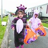 Zoey Snider (left) and her twin sister, Destiny, make their way through the Plattsburgh Housing Outlet as a dragon and unicorn during the 12th-annual Halloween Festival. All proceeds from the event benefit the Ronald McDonald House in Burlington, Vt.<br><br>(P-R Photo/Gabe Dickens)