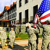 Tom Helveston, 20, Richard Lynch, 19, Andrew Streim, 21, (not shown) and Nick Petramale, 20, (from left) along with other cadets from the ROTC Program at Plattsburgh State, raise the flag in front of Clinton Community College after their Veterans Day ceremony.<br><br>(Staff Photo/Kelli Catana)