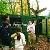 Steve Hall tells visitors about Luna, a great horned owl, during a recent presentation. The Adirondack Wildlife Refuge and Rehabilitation Center offers free educational tours daily.<br><br>(P-R Photo/Shaun Kittle)
