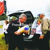 Salvation Army envoy Frank Smith carries a ham and a turkey donated by the Lake Champlain Turkey Talkers chapter of the National Wild Turkey Federation, a non-profit conservation organization that preserves hunting heritage. The 25 turkeys and 13 hams were provided by Dick Harwood (not shown) John Polewchak, Gloria Polewchak and Sandra Harwood (left) to help complete the annual Thanksgiving and Christmas dinners hosted by the Salvation Army.<br><br>(Staff Photo/Kelli Catana)