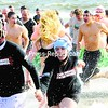 Participants exit the water after the annual Polar Plunge at the Plattsburgh City Beach Saturday. The plunge, which lasted less than two minutes, raised funds for Special Olympics. Check out video from this event at www.press republican.com.<br><br>(P-R Photo/Rob Fountain)