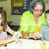 Becky Hess (center) helps Emily Hickey (left) and Dillon Uvyn with an art project at the Children's Development Group in Elizabethtown.<br><br>(Staff Photo/Alvin Reiner)