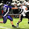 Ticonderoga's Corey King (78) chases down Cambridge's Ethan English (15) for a sack in Friday's NYSPHSAA Class D regional football game. The Indians defeated the Sentinels, 44-25.<br><br>(P-R Photo/Rob Fountain)