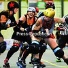 """North Country Lumber Jill Carly """"Carlovely"""" Lemieux cuts in to hit Twin City Riot's jammer at Central Vermont Roller Derby's first home bout in July, when the Lumber Jills won 125-140. The Lumber Jills will host Twin City Riot for their debut in the North Country on Saturday.<br><br>(Staff Photo/Kelli Catana)"""