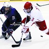 USA National Under-18 team member Matthew Lane (21) and Plattsburgh State's Jake Mooney (10) fight for the puck during an exhibition game at Stafford Ice Arena Saturday. The U.S. team won, 2-0.<br><br>(P-R Photo/Gabe Dickens)