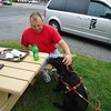 Christopher Paiser praises his new guide dog, Ike, during a recent lunch at McSweeney's restaurant in Plattsburgh. Paiser was blinded during an attack in Iraq. Ike is giving him new mobility and independence.<br><br>(P-R Photo/Stephen Bartlett)