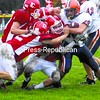 Saranac Lake's Devin Darrah (10), Ben Monty (12) and Lance Ackerson (center) stop Potsdam's Dominic Centofanti (23) during a Northern Football Conference crossover game at Ken Wilson Field Saturday. The Red Storm won, 31-14. For all Section VII/X football stories, go to Pages B4 and B5.<br><br>(Staff Photo/Ryan Hayner)