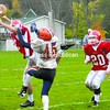 With teammate T.J. Monroe (20) looking on, Saranac Lake's Ben Monty breaks up a pass intended for Potsdam's Jesse Bradish (45) during a crossover Northern Football Conference game at Ken Wilson Field Saturday. The Red Storm won, 31-14.<br><br>(Staff Photo/Ryan Hayner)