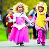 A wand might make some magic as Olivia Gottlob and Mazie Sellars (above, left to right) race in the Fall Fun Run series on the Terry Gordon Memorial Bike Path, but holding hands helps, too. Runners were encouraged to wear their Halloween costumes for the Clinton County Youth Bureau event held near U.S. Oval in Plattsburgh. Kade Sellars (left) isn't draggin' as he makes his way to the finish line during the final Fall Fun Run of the season. He was one of almost 50 runners who turned out for the ¼-, ½- and 1-mile runs. See video of this event at www.pressrepublican.com.<br><br>(P-R Photos/Rob Fountain)
