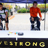 Rich Adickes (left) and Charlie Stewart keep the pedals going during a Livestrong fundraiser to benefit the Lance Armstrong Foundation. Students kept the bike pedals going for 12 hours straight and hoped to reach their goal of raising $1,500. <br><br>(Staff Photo/Kelli Catana)