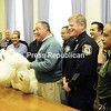 With a giant stuffed polar bear as a mascot, the details are announced for the second Freezin' For A Reason Plattsburgh Polar Plunge, set for Nov. 12, to benefit Special Olympics. Shown are (from left) City Councilor Tim Carpenter; Essex County Sheriff Richard Cutting; City Councilor George Rabideau; Clinton County Sheriff David Favro; Essex County District Attorney Kristy Sprague; Federal Protective Service Police Officer Scott Ewing; Plattsburgh Mayor Donald Kasprzak; Customs and Border Protection Air and Marine representative Gregory Haynes; City Police Capt. Mike Branch; Customs Deputy Director Jim Diskin; and Border Patrol officer Howard Perez.<br><br>(Staff Photo/Kelli Catana)
