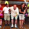 Deb Brunner (left), Harry Durgan, James Jackson and Sharlene Petro-Durgan compete in the crowd-favorite horse races at Elks Lodge 621 in Plattsburgh during the Kiwanis Noon Club's annual senior picnic.<br><br>(P-R Photo/Gabe Dickens)
