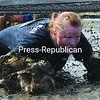 Kathleen Bramich-Brack crawls through a mud pit while closing in on the finish line at the Plattsburgh City Beach during the Rockeater Adventure Race Saturday.<br><br>(P-R Photo/Rob Fountain)