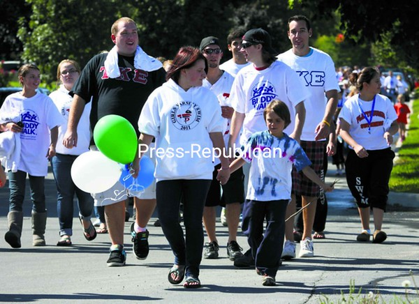 Hundreds participated in the annual Buddy Walk Sunday afternoon at Melissa L. Penfield Park in Plattsburgh. Sponsored by the National Down Syndrome Society, there are nearly 300 Buddy Walks planned throughout the year across the nation to promote acceptance of those with Down Syndrome.<br><br>(P-R Photo/Gabe Dickens)