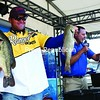 Pro leader David Wolak shows off his catch on the day three weigh-in of the Walmart FLW Tour event on Lake Champlain at Walmart on Saturday. Wolak took the lead heading into the final day.<br><br>(P-R Photo/Gabe Dickens)
