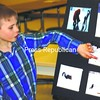 Chandler Perry discusses his activities with his squirrel friends as his 4-H presentation.<br><br>(Staff Photo/Alvin Reiner)