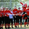 Plattsburgh State's Katie McNally leaps in celebration as she crosses the plate with her teammates awaiting after hitting a home run in the first game of a SUNYAC softball doubleheader against Geneseo Friday. The Cardinals earned a split and will host Brockport today.<br><br>(P-R Photo/Rob Fountain)