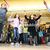 Rouses Point Elementary School students and their families take part in a Just Dance workshop during the Hoppin' and Boppin' Family Fun Night at the school. The recent event included Zumba, relay races, an art workshop, raffles and more.<br><br>(P-R Photo/Rob Fountain)