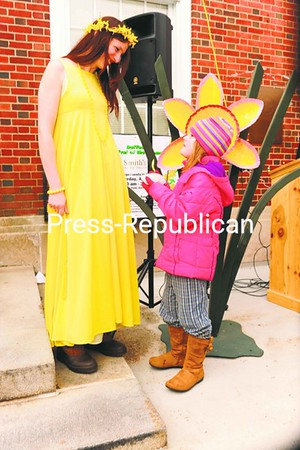 Sarah Curtis of Saranac Lake (left), dressed in her daffodil-yellow dress, talks with Lela Pell, 5, during the village's Daffest. Thousands attended the event.<br><br>(P-R Photo/Jack LaDuke)