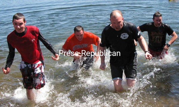 AuSable Forks volunteer firefighters (from left to right) Kody Hart, Chris Thwaits II, Derrick Martineau and Doug Seguin braved 40-degree water Saturday to participate in the first annual AuSable Forks Fire Department Polar Plunge at Fern Lake. Seguin organized the event, which raised $600 to train two of the station's volunteers in swift-rescue techniques.<br><br>(P-R Photo/Shaun Kittle)
