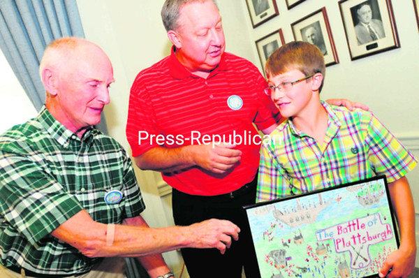 Kit Booth, an organizer of the Battle of Plattsburgh Commemorative Weekend (left), and City of Plattsburgh Mayor Donald Kasprzak congratulate   Garrett Lemza on his artwork capturing the spirit of the 1814 fight on land and lake. He won first place in the fourth-grade   contest, so his design will be showcased on this year's Battle of Plattsburgh button that gives entry to numerous events Aug.   31 through Sept. 9.<br><br>(Staff Photo/Kelli Catana)