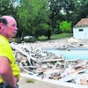 Owner Bob Stoeckert looks over the pool and bathhouse at the AuSable River Campsite that remain damaged one year after Tropical Storm Irene.<br><br>(Staff Photo/Kelli Catana)