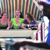 Caitlin Bilow (left to right) and Brittany Cassavaw of Moriah and Kera Ghostlaw of Fort Covington catch a ride on the Pharoah as it swings back and forth, gaining altitude with each pass during the opening day of the 162nd-annual   Franklin County Fair in Malone Saturday afternoon. The fair lasts through next Sunday.<br><br>(P-R Photo/Gabe Dickens)