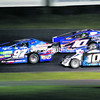 Kris Vernold (97), eventual winner Patrice McGrail (10) and Roger Labreche vie for position during the Modified race Saturday at Airborne Speedway.<br><br>(P-R Photo/Gabe Dickens)