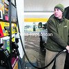 Dave Webb of Lake Placid fills up the gas tank of his Ford F-250 at the Sunoco on Cornelia Street in Plattsburgh Sunday afternoon. He doesn't drive the big truck too far, thinking of the cost to fuel it up.<br><br>(P-R PHOTO/GABE DICKENS)