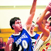 Johnsburg's Dylan Moore (50) tries to block a shot attempt by Keene's Warren Ashe during Tuesday's Mountain & Valley Athletic Conference boy's basketball game. The Jaguars hung on for a 19-16 victory over the Beavers.(P-R Photo/Alvin Reiner)