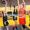 Clinton Community College's Jessica Decker (20) puts up a shot against Adirondack Community College during Tuesday's women's college basketball game. The Timberwolves' Shelby Graham (left) and Jaime McLaughlin (right) defend on the play. The Cougars won in overtime, 61-54.<br><br>(P-R PHOTO/ROB FOUNTAIN)