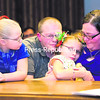 Bill and Nickie Walker of Granville sit with their newly adopted children, Isabelle (left), 6, and Kyia, 8, along with 10-year-old Deona (not pictured) during a court hearing in Plattsburgh to finalize the process.<br><br>(P-R Photo/Gabe Dickens)