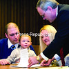 Attorney Kevin Peryer (right) hands Robert and Valerie Cioffi papers to sign for the adoption of 3-year-old twins Christopher (shown) and Chloe (not pictured).<br><br>(P-R PHOTO/GABE DICKENS)