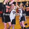 Indian Lake/Long Lake's Meg Smith (34) goes up for a layup with Westport's Emily French (15) and Karlee McGee (13) during a Section VII Class D girls' basketball semifinal game at AuSable Valley Central School Tuesday. The Orange won, 47-42. Bonus photos will be available midday at www.pressrepublicanphotos.com.<br><br>(P-R Photo/Rob Fountain)