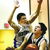Lake Placid's Jacob Daniels (right) tries to get through Ticonderoga's Joe Gonyeau during a Section VII Class C boys' basketball semifinal game at Willsboro Central School Tuesday. Ticonderoga won, 55-32.<br><br>(Staff Photo/Alvin Reiner)