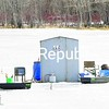 Anglers get ready for ice fishing near the Vermont end of the Korean Veterans Memorial Bridge in Rouses Point. Mild weather this winter has kept much of Lake Champlain's water open, but those who fish share space in the areas that have frozen.<br><br>(P-R Photo/Rob Fountain)